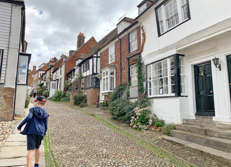 My son exploring a cobbled street in Rye, Sussex UK