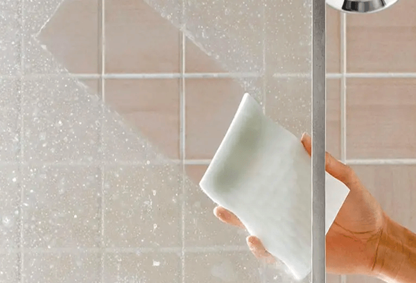 remove soap scum from shower walls