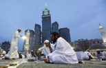Worshippers eat during Iftaar, or breaking of the fast, at the Grand Mosque in the holy Muslim city of Mecca, Saudi Arabia, Wednesday, July 10, 2013