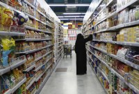 A woman looks at products as she buys food supplies for Ramadaan at a supermarket in Dubai, on July 8, 2013