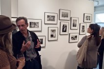 Havana opening, wall of black and white photos.