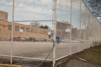 Fenced basketball court.