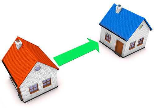Two little house models with an arrow between