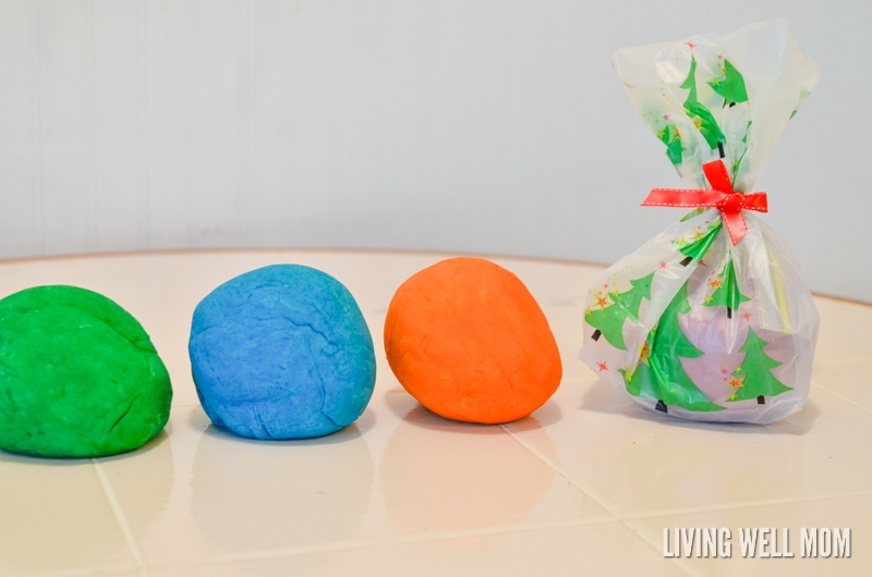 This easy homemade playdough for Christmas takes just 5 minutes and 6 simple ingredients to make! It's a perfect homemade Christmas gift or stocking stuffer that kids love! Get the easy step-by-step recipe here: