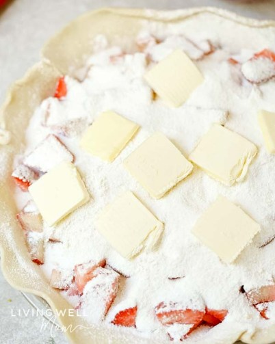 strawberry rhubarb pie filling with sugar and butter