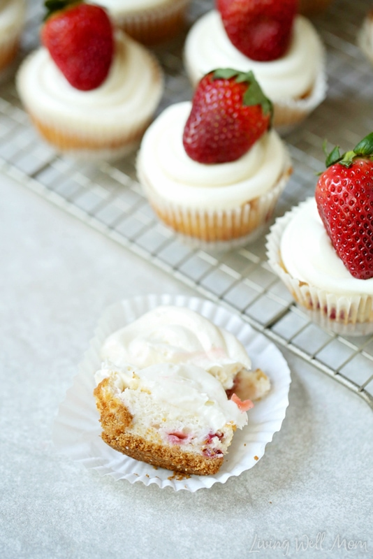 Love cheesecake and strawberries? You'll be in heaven with this tasty Strawberry Cheesecake Cupcakes recipe! With a graham cracker crust, light cupcake with strawberry chunks, and a cheesecake frosting, this is one delicious strawberry dessert!