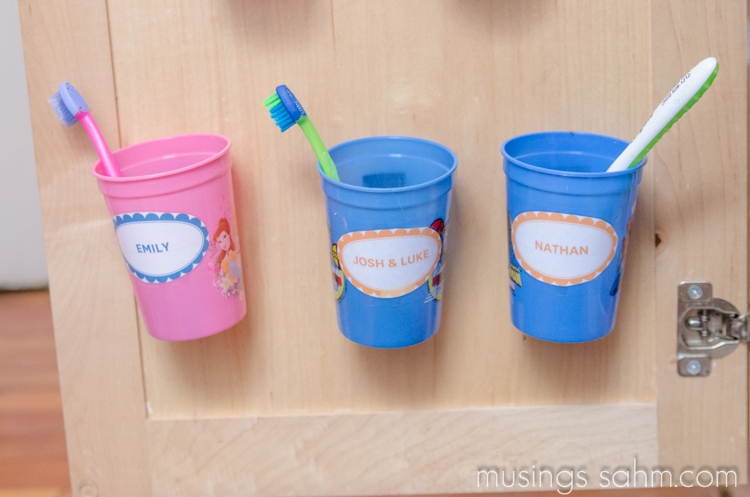 Keep kids' toothbrushes off the counter and hidden with this handy organizing idea!