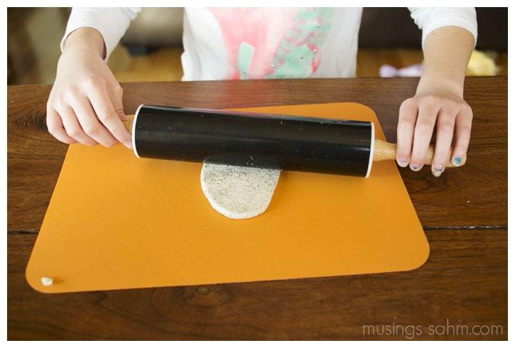 adding glitter to salt dough snowflakes