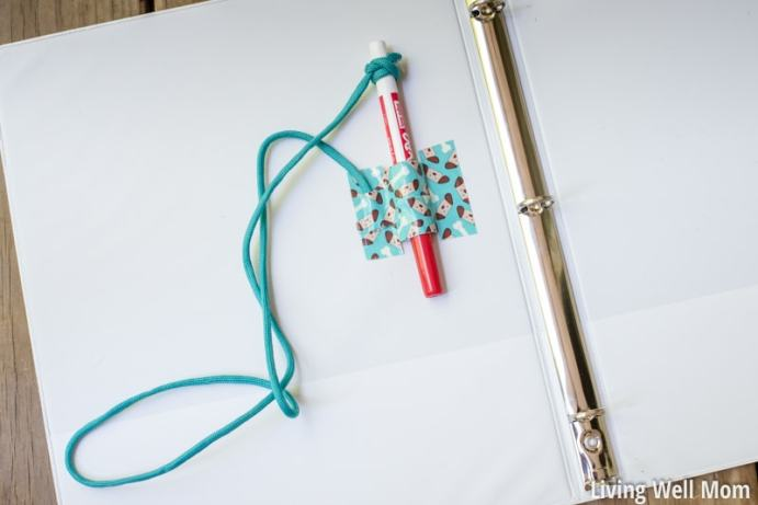 dry erase expo marker holder attached in kids binder