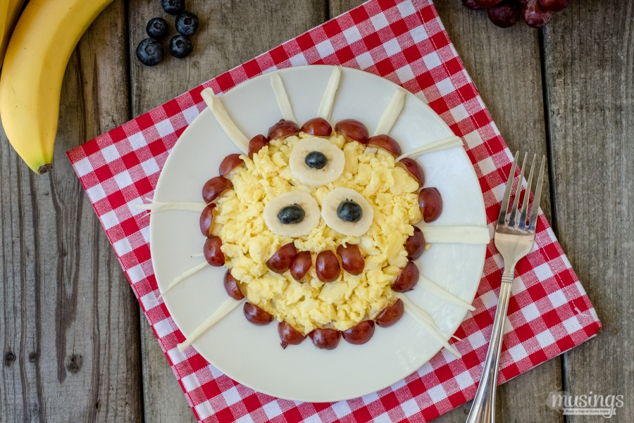 "This quick-and-easy Scrambled Eggs & Cheese Monster is a fun breakfast with a cheesy twist. You'll love that this recipe for kids is packed with protein and they'll love creating their own ""monster"" with delicious fresh fruit!"