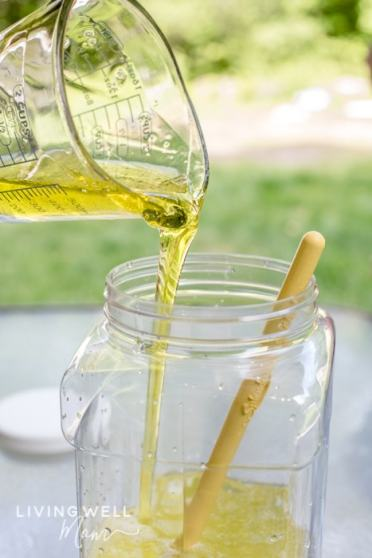 adding soap for making homemade bubbles recipe