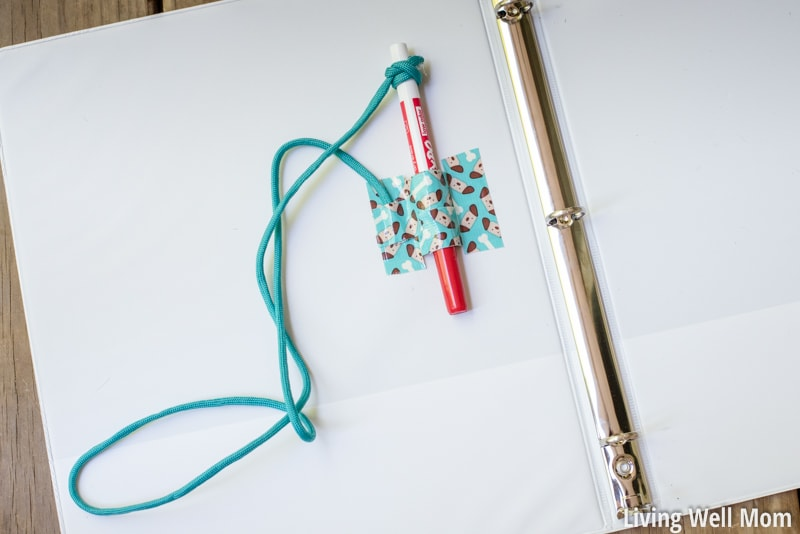 road trip travel binder with attached dry erase marker