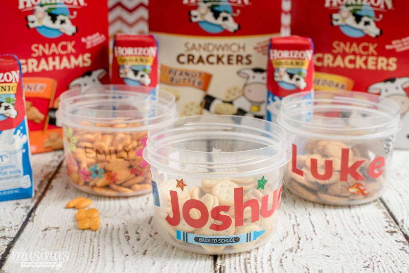 Easy-to-make and inexpensive, this DIY personalized Travel Snack Cup is a hit with both kids and moms!