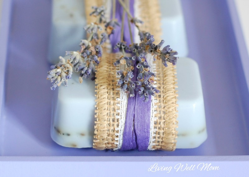 This homemade lavender goat milk soap recipe is easy to make (it takes less than an hour to make 12 bars!) and smells incredible with added essential oils.
