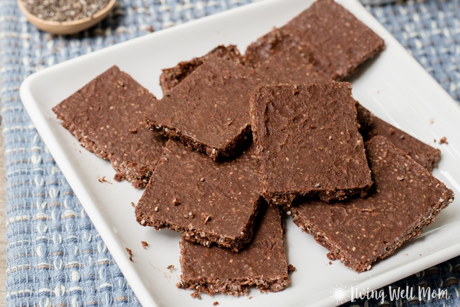 These deliciously crunchy Paleo Chocolate Crunch Energy Bars provide an amazing energy boost! Plus you'll love that this recipe is guilt free - there's no refined sugar and the coconut, cacao, and chia seeds all have wonderful benefits!