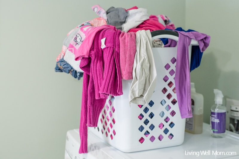 Had enough with the never-ending mountain of laundry? With four kids, I was too. Here's how a simple laundry routine saved my sanity and helped me tame the laundry beast. Plus a free printable!