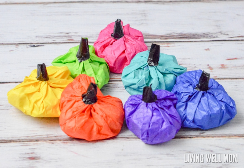 """Forget all that candy and hyped up children! These Surprise Pumpkin Treat Bags can be filled with non-candy surprises that kids will love just as much. Perfect for party favors, classrooms, or at-home fun, these """"pumpkins"""" are quick and easy enough for kids to help make!"""
