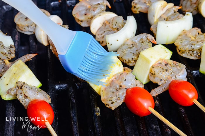 grilled shrimp skewers cooking with marinade