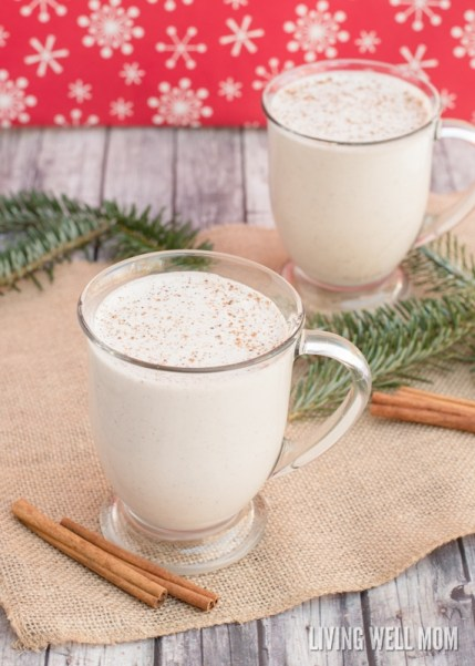 eggless vegan eggnog in a glass with cinnamon sticks and pine branches