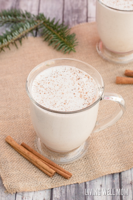 eggless eggnog in a glass with nutmeg and pine needles