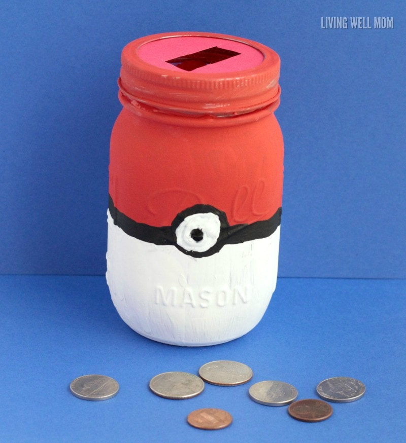 This Pokeball mason jar piggy bank craft project is perfect for your little Pokemon fan! It's an easy DIY project and a great way to get kids to save money!