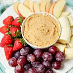 This quick and easy Peanut Butter Fruit Dip is a tasty way to add protein to a fun snack for kids. With dairy-free and nut-free options, you can easily tweak this recipe for almost any dietary needs.