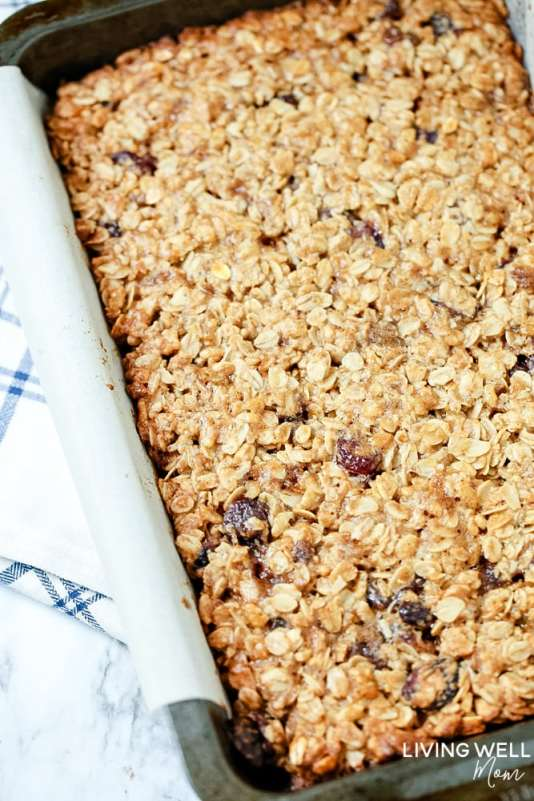 Cranberry Granola Bar Squares are a nutritious, moist, chewy granola bar square filled with oats, crispy rice, and dried cranberries. This is an easy, delicious, gluten-free and dairy-free snack recipe kids love!
