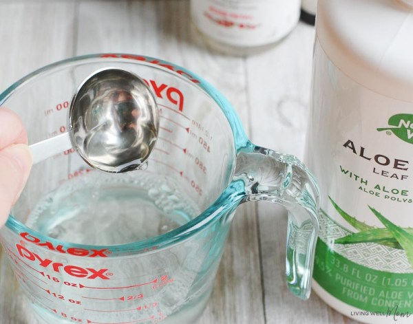 mixing aloe vera into homemade face toner