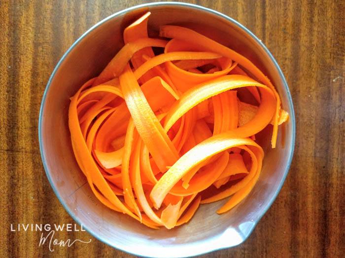 peeled spiralized carrots in a bowl