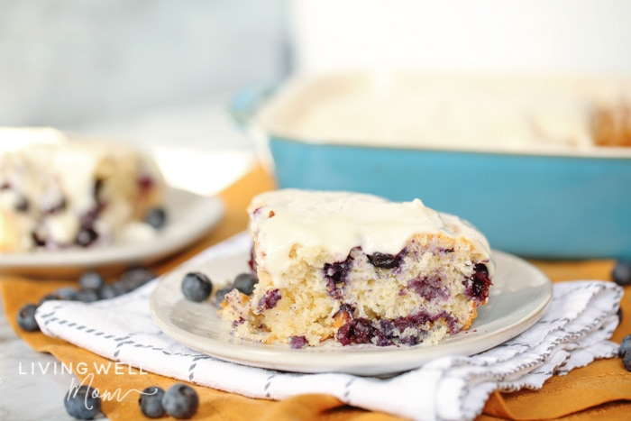 delicious blueberry dump cake with cream cheese dessert on a plate with blueberries on the napkin