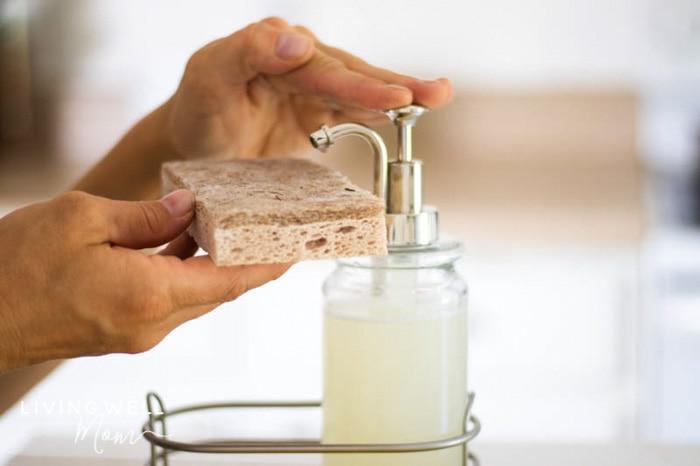 putting liquid homemade dish soap on a sponge