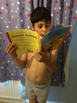 Reading Handa's Surprise.