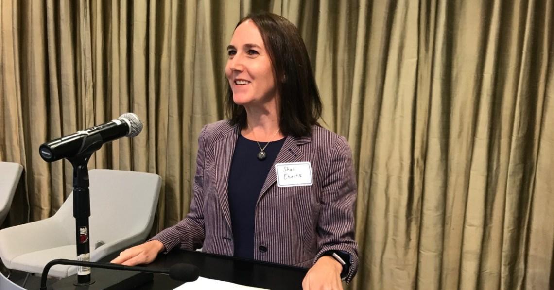woman-speaking-at-podium