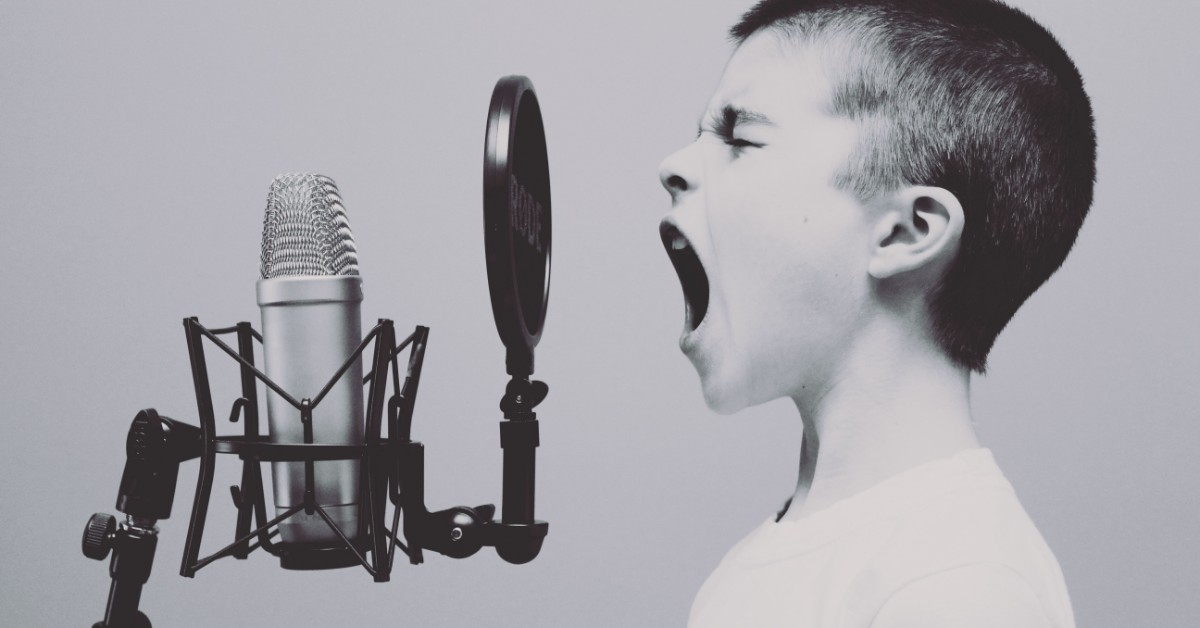 boy-screaming-into-microphone