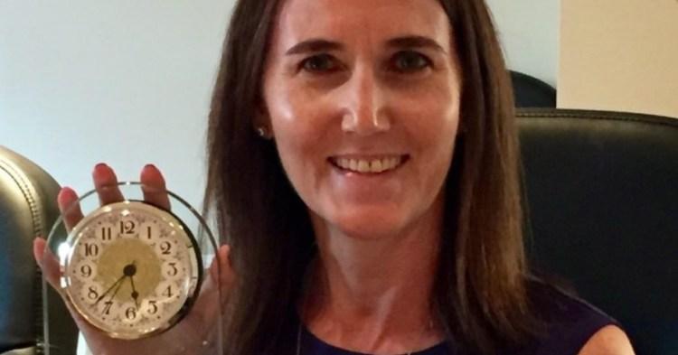 woman-holding-clock-award