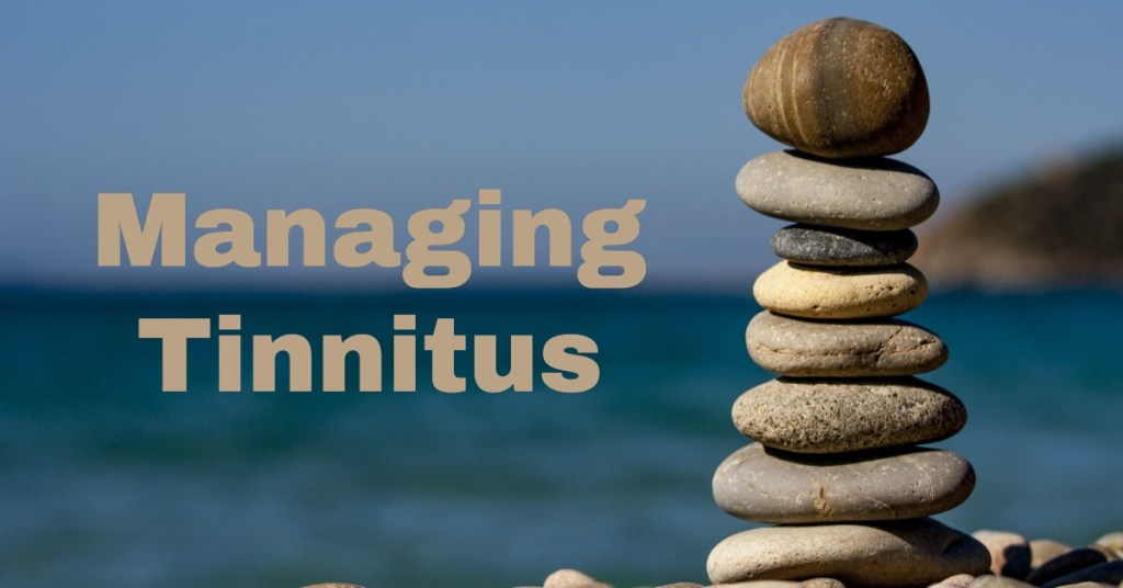 meditative-stack-of-stones-with-words-managing-tinnitus