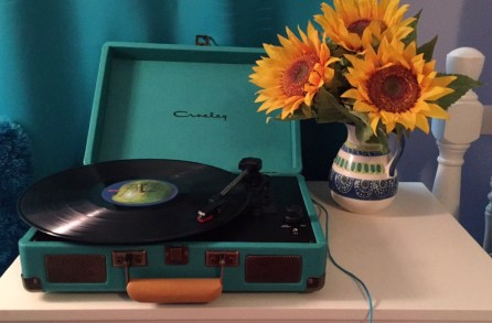 I own a Crosley record player as well as a Sony...and sunflowers are my favorite flower:)