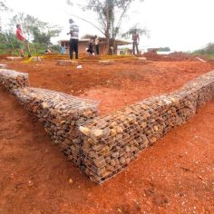 Trenches-dug-wire-mesh-cages-made-stones-collected-from-around-the-village-Gabion-walls-completed-to-retain-our-site.