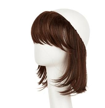 Hairpiece giver mulighed for lidt hår under huen