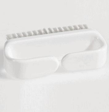 Blød børste til rengøring af klæbeprotese