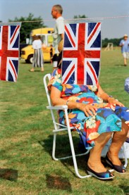 GB. England. Sedlescombe. British flags at a fair. 1995-1999.