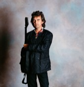 Fogerty said 'yes' so here's the photograph with his guitar, but George turned it backwards.
