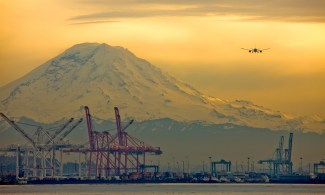 Another view of Seattle's port, with Mt Rainier looming, airliners on final approach for SeaTac.