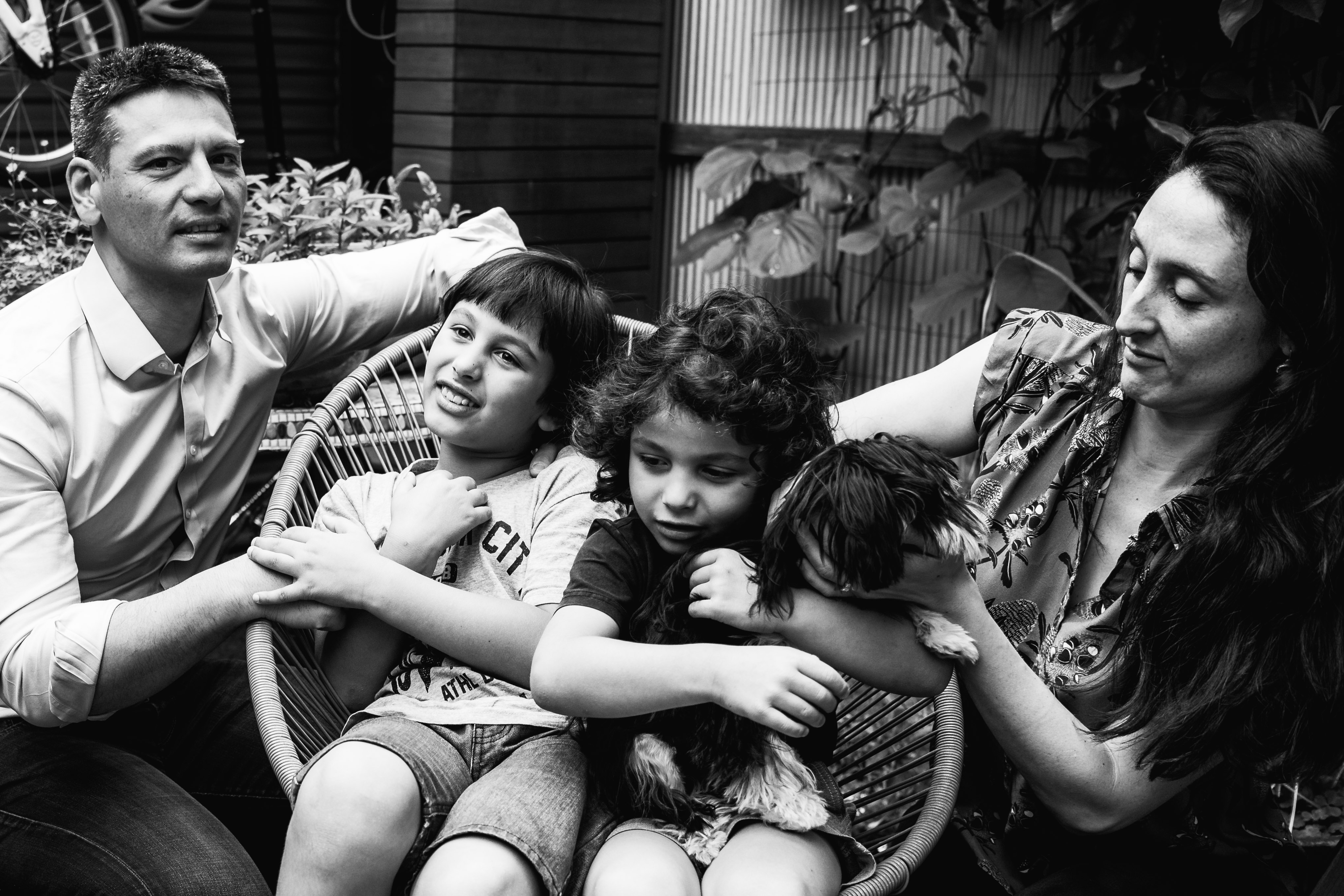 photograph of a family sitting in their backyard in Carlton North, Melbourne, Australia