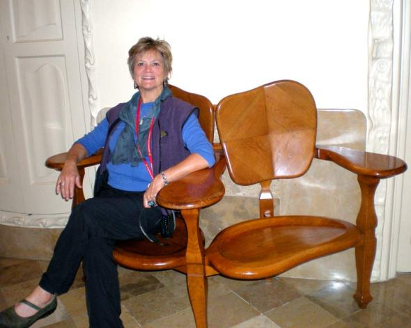 At La Pedrera, Barcelona. Seated in a chair designed by Gaudi