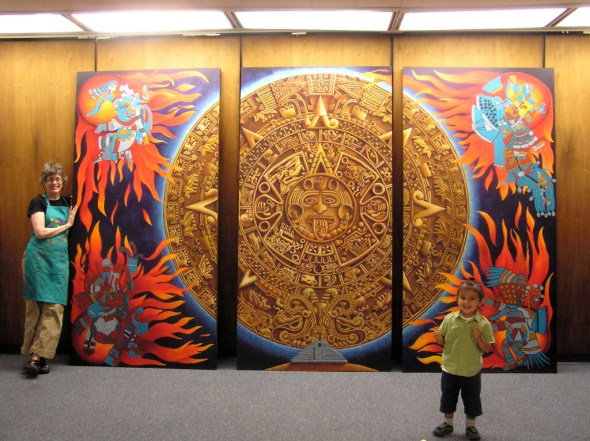 Lin installing the YDDC Aztec Calendar Mural in the Pera Building in Santa Fe New Mexico
