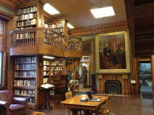 The library is elegant, warm, and cozy all at the same time. I love the many spiral staircases.