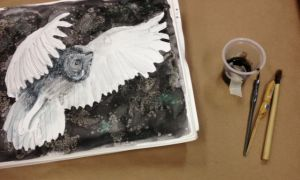 Ink is much less likely to spill if it is taped to the table. Especially when I'm  experimenting  like with this owl in flight.