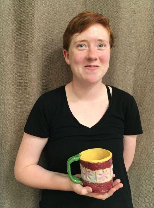 Bright personal handbuilt ceramic mug. Glazed clay. Great for your morning tea.