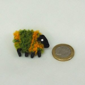 scale|euro-coin|green_and_gold|sheep|brooch